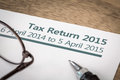 Tax return uk hmrc income form for on a desk with pen and glasses Royalty Free Stock Photos