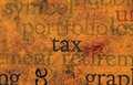 Tax text on grunge background close up of Stock Images