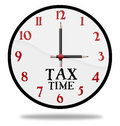 Tax time clock analog with pencils for hands and the words Royalty Free Stock Photo