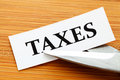 Taxes deduct over wooden table Royalty Free Stock Photo