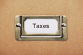 Taxes storage drawer label a for in a metal holder on the outside of a cardboard box Royalty Free Stock Images