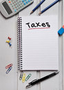 Taxes word on notebook page Stock Images