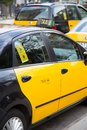 Taxi barcelona typical yellow and black of Stock Photography