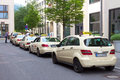 Taxi berlin may a row of s in a street in the business is heavily regulated in germany most of cities have typical Royalty Free Stock Photography