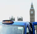 Taxi cab in front of big ben closeup clock tower and houses parliament london england Royalty Free Stock Photography