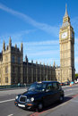 Taxi cab near of Big Ben Stock Images