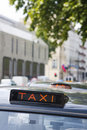 Taxi cab sign Stock Images