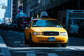 Taxi cab on the street of new york usa yellow rides in Stock Photos
