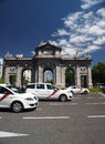 Taxi cabs driving around puerto de alcala madrid spain europe m momorial gate rotunda round about circle Royalty Free Stock Images