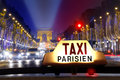 Taxi at the champs elysees Royalty Free Stock Photo