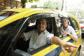 Taxi driver showing passenger a landmark