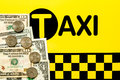 Taxi fare concept money on the black and yellow background Stock Photos