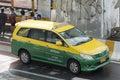 Taxi innova van thailand taxi running on the road in bangkok Royalty Free Stock Photo