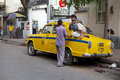 Taxi in kolkata india a local driver is sitting on the along the street around hogg market the metered cabs are mostly of the Stock Photos