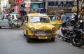 Taxi in kolkata india urban scene a local along the street around hogg market the metered cabs are mostly of the brand ambassador Royalty Free Stock Photos