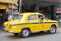 Taxi in kolkata india urban scene a local driver is driving along the street around hogg market the metered cabs are mostly of the Stock Photography