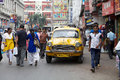 Taxi in kolkata india urban scene a local driver is driving among the people along the street around hogg market the metered cabs Royalty Free Stock Image