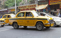 Taxi in kolkata india urban scene a local driver is driving the traffic the metered cabs are mostly of the brand ambassador Royalty Free Stock Photography