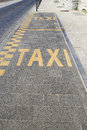 Taxi lane for parking with yellow signs Royalty Free Stock Image