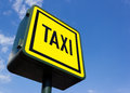 Taxi rank sign under blue sky Stock Photos