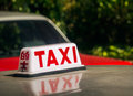 Taxi signage hong kong red on the road Royalty Free Stock Photo