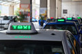 Taxi signs in line Royalty Free Stock Photo