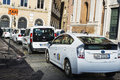 Taxi stand with many white taxis in Rome, Italy