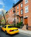 Taxi in the village yellowcab passes by greenwich apartments new york city Royalty Free Stock Images