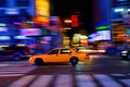 Taxicab on city street Stock Photos