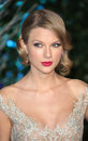 Taylor swift arriving for the winter whites gala dinner held at kensington palace london picture by henry harris featureflash Royalty Free Stock Image