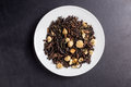 Tea asian flowers oolong on white plate on dark backgroung Royalty Free Stock Photo