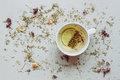 Tea background. Dry herbal tea and cup of hot tea on the gray background. Copy space