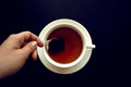 Tea bag into a white cup . Royalty Free Stock Photo