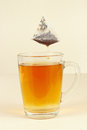 Tea bags over glass with brewed tea the Stock Photos