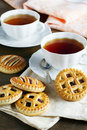 Tea and biscuits with jam two cups of Royalty Free Stock Photo