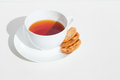 Tea and biscuits relax unwind with a cup of on white background Royalty Free Stock Image