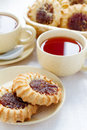Tea and biscuits two cups of with jam Royalty Free Stock Image