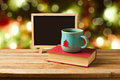 Tea and books with chalkboard over Christmas background Royalty Free Stock Photo