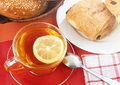 Tea breakfast cup of with lemon and sweet bakery on the table Stock Image