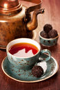 Tea and chocolate candies in a vintage style Royalty Free Stock Images