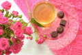 Tea, chocolates and pink roses Stock Photography