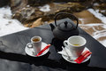 Tea and coffee cup pot set on black shiny table Royalty Free Stock Photo