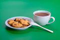 Tea and cookies white cup of hot on green background Royalty Free Stock Photos