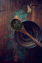 Tea culture green leaves gun powder on a wooden spoon Stock Photo