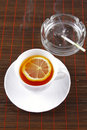 Tea cup and ashtray with cigarette Royalty Free Stock Images