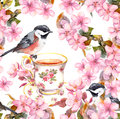 Tea cup, birds and flowers. Seamless floral pattern. Aquarelle drawing on white background