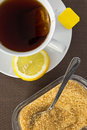 Tea cup brown sugar and slice of lemon aerial view Stock Images