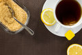 Tea cup brown sugar and slice of lemon aerial view Royalty Free Stock Images