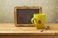 Tea Cup And Chalkboard On Wood...