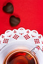 Tea cup and chocolate candy Stock Image